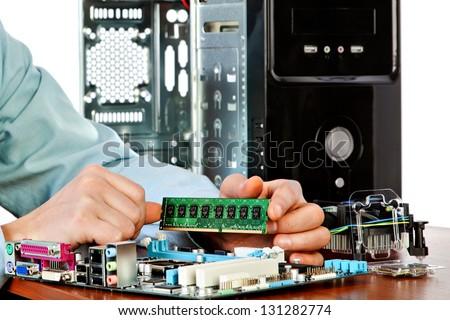 Technician repairing computer hardware in the lab.  Studio shot. Small DOF - stock photo