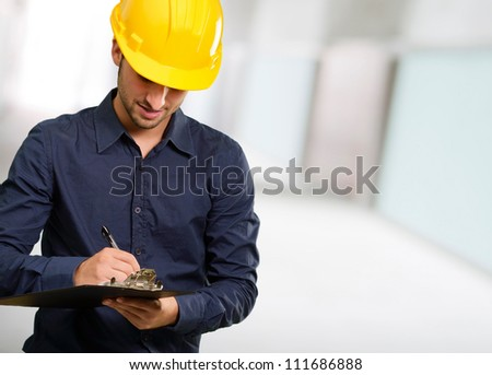 Technician Using Clipboard, Indoor - stock photo