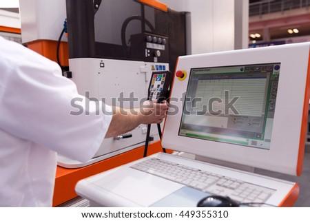 Technician working at programmable machine. CNC technology.  - stock photo