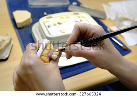 Technician working  in dental lab.