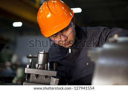 Technician working in factory shallow focus - stock photo