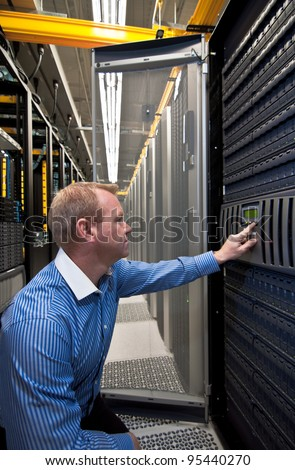 Technician working on a large scale Storage server - stock photo