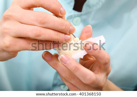 Technician working on dentures  - stock photo