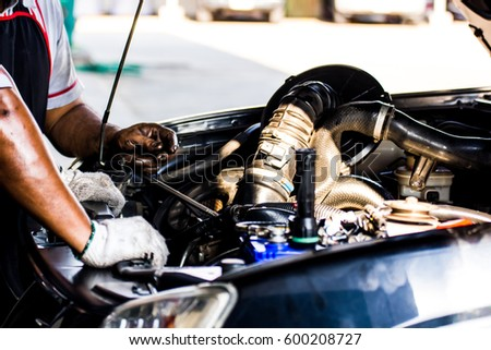 technicians are checking car engines