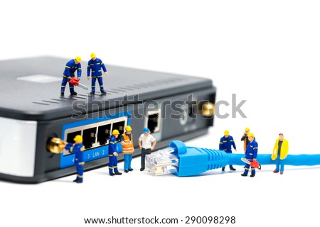 Technicians connecting network cable. Network connection concept. Macro photo - stock photo