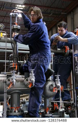 Technicians in teamwork. - stock photo