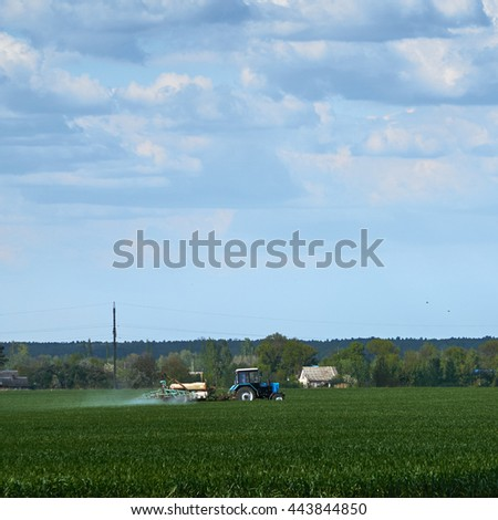 Technique is working on the field for a good harvest.                                - stock photo