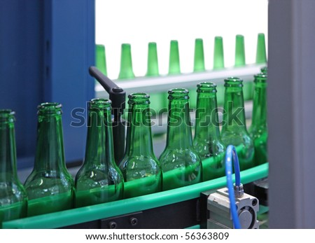 Technological line for washing of glass bottles for beer - stock photo
