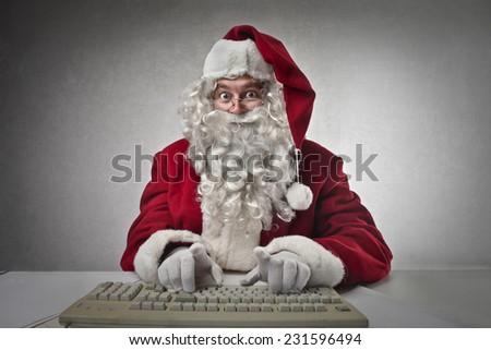 Technological Santa Claus  - stock photo