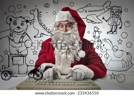Technological Santa Claus ordering toys for kids  - stock photo