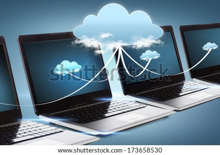 technology and advertisement concept - many laptop computers with blank black screens - stock photo