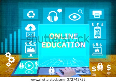 technology and biz concept. working on his laptop in the secured office, select  icon  online education on the virtual display - stock photo