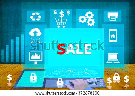technology and biz concept. working on his laptop in the secured office, select icon sale  on the virtual display - stock photo