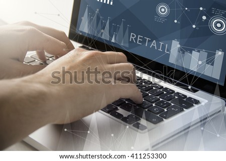 technology and business concept: man using a laptop with retail on the screen. All screen graphics are made up. - stock photo
