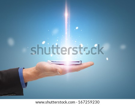technology and communication concept - close up of man hand with smartphone - stock photo