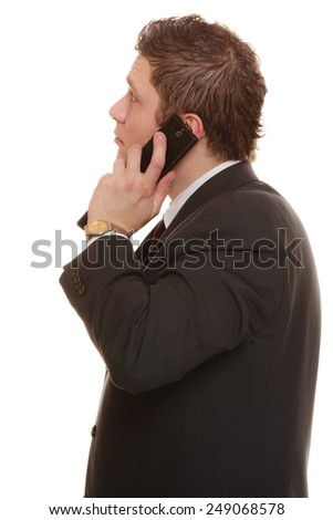 Technology and communication - confused businessman talking on mobile cell phone smartphone, worried man using cell phone isolated. Misunderstanding. - stock photo