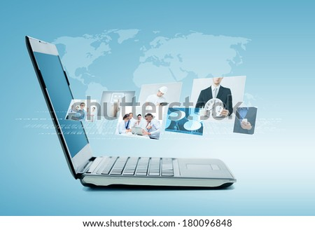 technology and news concept - laptop computer with news on screen - stock photo