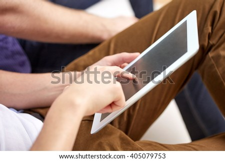 technology and people concept - close up of male hands with tablet pc computer blank screen at home