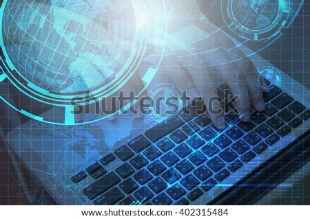 Technology Background of Hand use Notebook computer with Earth globe, Double Exposure. - stock photo
