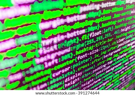 Technology background. Website development. Developer working on websites codes in office. Programming code on computer screen. Source code photo. Writing program code on computer.
