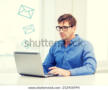 technology, business and communication concept - man in eyeglasses working with laptop at home - stock photo