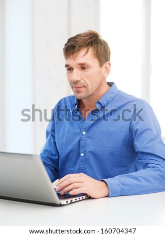 technology, business and lifestyle concept - man working with laptop at home