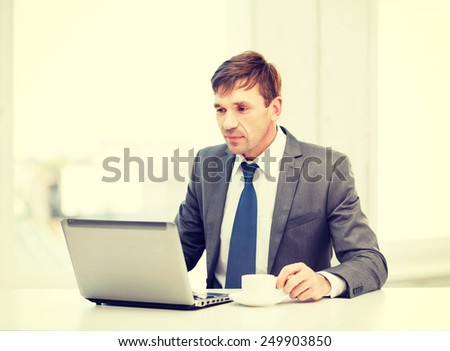 technology, business and office concept - handsome businessman working with laptop computer - stock photo