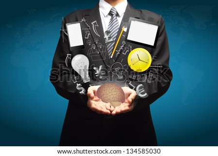Technology business creative ideas in the hands of businessmen - stock photo