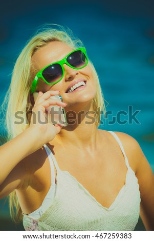 Technology communication and holidays. Young woman pretty girl talking on mobile cell phone using smartphone on beach