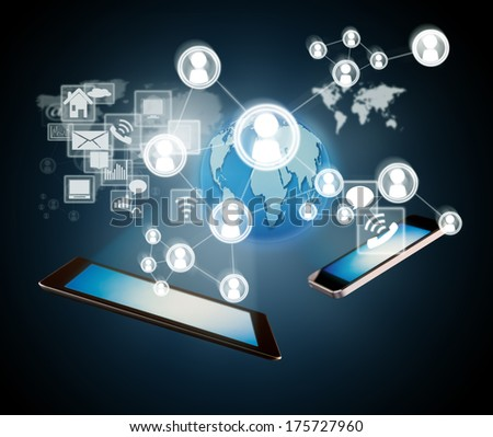 Technology concept with smart phone and tablet and virtual icons around - stock photo