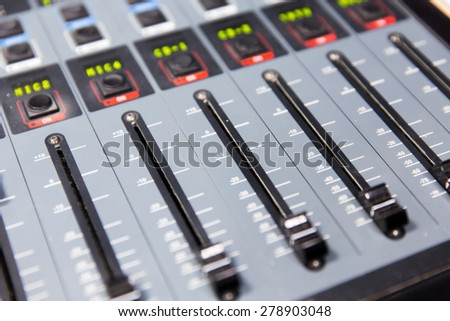 technology, electronics and equipment concept - control panel at recording studio or radio station - stock photo