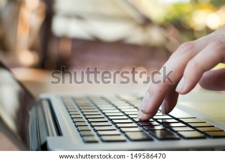 technology, fingers touch keyboard - stock photo