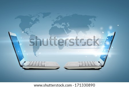 technology, internet and connection concept - two laptop computers with world map hologram - stock photo