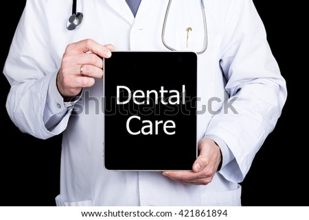 technology, internet and networking in medicine concept - Doctor holding a tablet pc with dental care sign. Internet technologies in medicine - stock photo