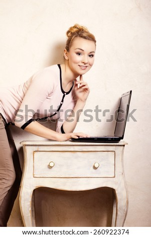 Technology internet modern lifestyle. Young businesswoman woman student girl working on computer laptop at the retro desk. Business at home. - stock photo