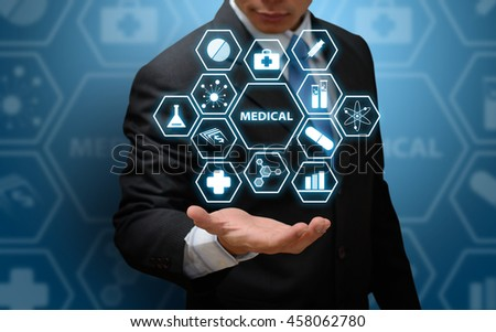 technology medical concept : Business man hold the medic icon