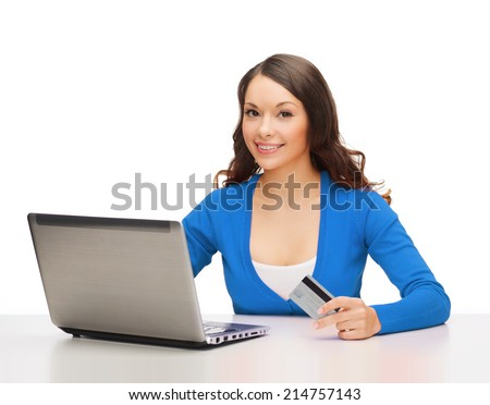 technology, online shopping and payment concept - smiling woman with laptop computer and credit card