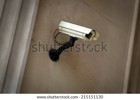 Technology Photography: Security camera on a gray wall