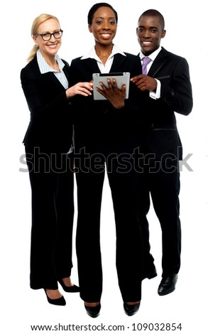 Technology savvy business team using tablet pc. Business concept - stock photo