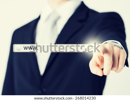 technology, searching system and internet concept - businessman pressing Search button - stock photo