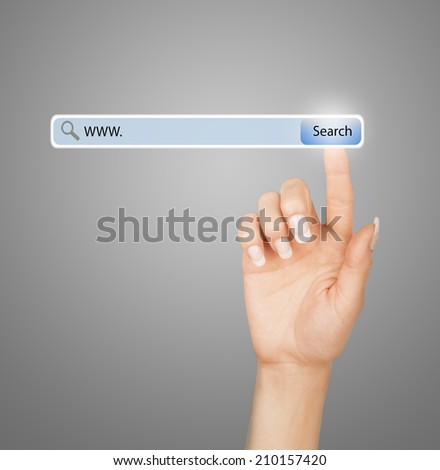 technology, searching system and internet concept - woman hand pressing Search button