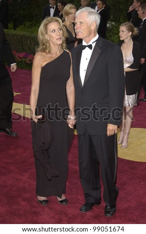 TED TURNER & date at the 76th Annual Academy Awards in Hollywood. February 29, 2004