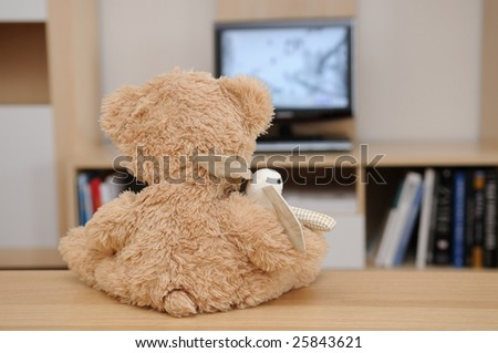 Teddy and bunny watching the television - stock photo