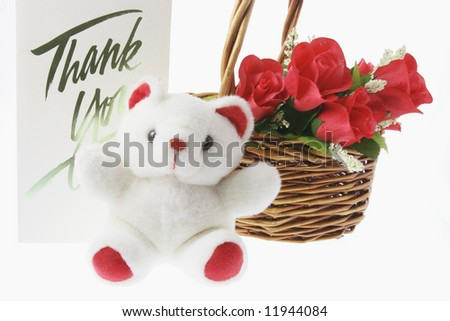 Teddy Bear and Basket of Red Roses on White Background - stock photo