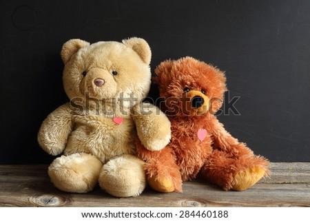 teddy bear and friend, two teddy bears, sweet bear with a heart - stock photo