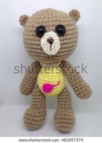 teddy bear doll crochet on white background