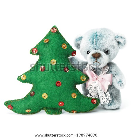 Teddy bear in classic vintage style with christmas tree isolated on white background - stock photo
