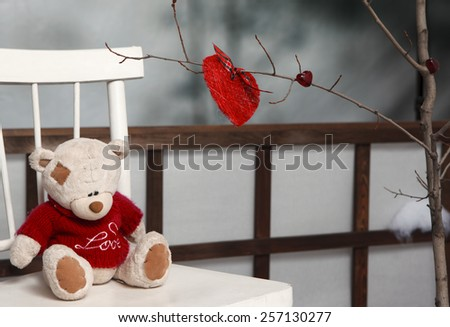 Teddy bear in Valentine's day on back of chair