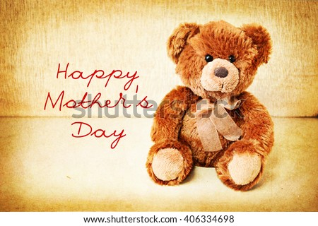 Teddy bear on a vintage table. Happy Mother's Day - stock photo