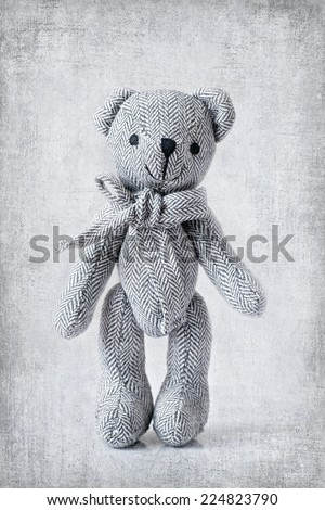 teddy bear on an old style background - stock photo